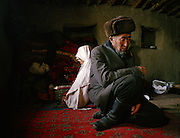 Evening prayer time at Haji Osman's house..Campment of Tshar Tash (Haji Osman's camp), in the Wakhjir valley, at the source of the Oxus..Winter expedition through the Wakhan Corridor and into the Afghan Pamir mountains, to document the life of the Afghan Kyrgyz tribe. January/February 2008. Afghanistan valley, at the source of the Oxus..Winter expedition through the Wakhan Corridor and into the Afghan Pamir mountains, to document the life of the Afghan Kyrgyz tribe. January/February 2008. Afghanistan