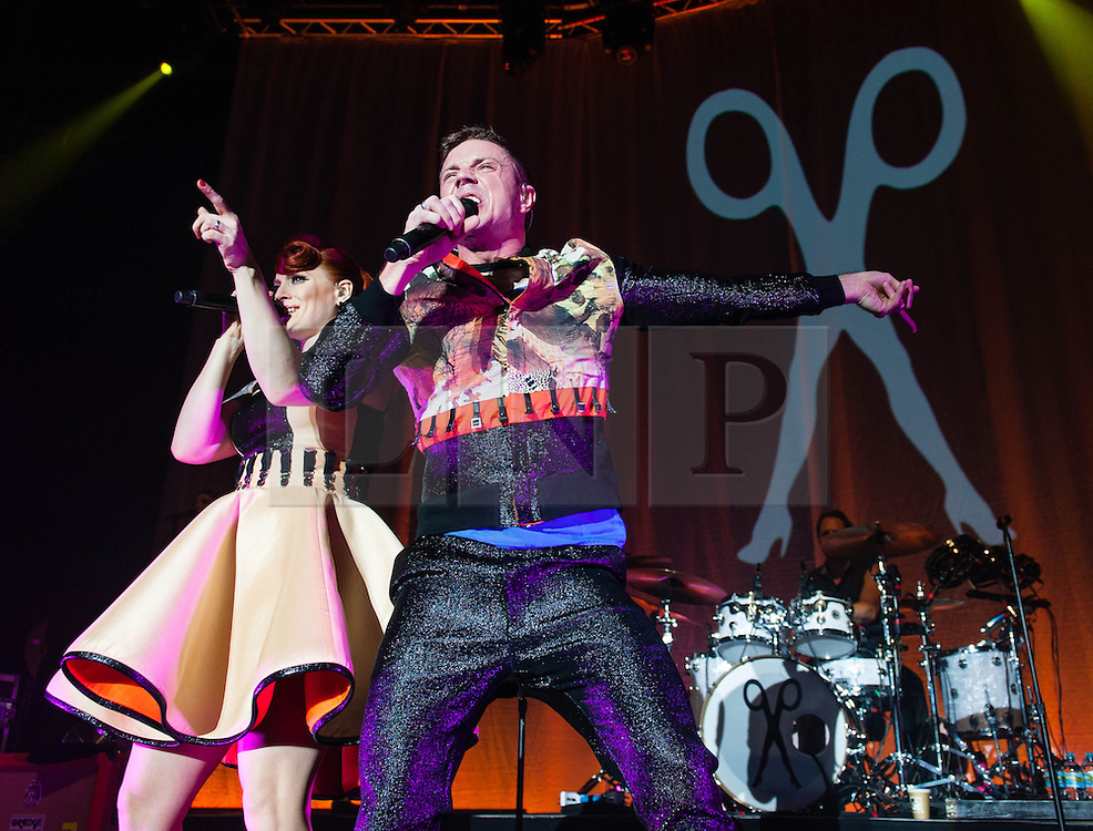 © Licensed to London News Pictures. 23/10/2012. London, UK.   Ana Matronic (Left) and Jake Shears (Right) of Scissor Sisters performing live at Camden Roundhouse. Scissor Sisters are an American band formed in 2001.  The band took their name from a sexual position between two women also known as tribadism.  Its members comprise Jake Shears and Ana Matronic as vocalists, Babydaddy as multi-instrumentalist, Del Marquis as lead guitar/bassist, and Randy Real as drummer. Scissor Sisters have incorporated diverse and innovative styles in their music, but tend to sway towards pop rock, glam rock, nu-disco, and electroclash.  Photo credit : Richard Isaac/LNP