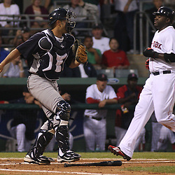 March 14, 2011; Fort Myers, FL, USA; Boston Red Sox designated hitter David Ortiz (34) is forced out at homeplate by New York Yankees catcher Jesus Montero (83) during a spring training exhibition game at City of Palms Park.   Mandatory Credit: Derick E. Hingle