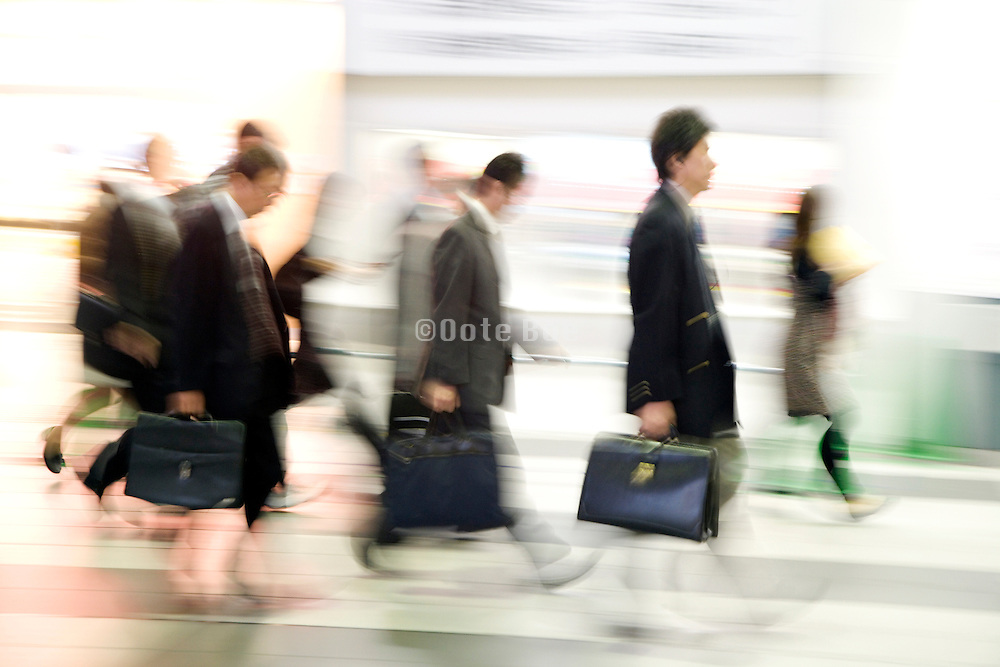 businesspeople walking all in the same direction