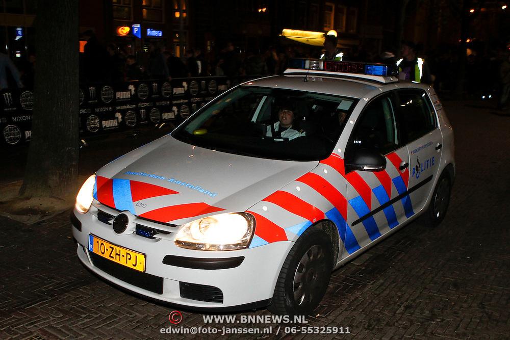 NLD/Amsterdam/20100501 - Gumball 3000 Amsterdam, politieauto komt kijken wat er aan de hand is