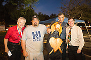 Milpitas Black Bear Diner co-owner Celina Gonzales, sculptor Ray Schulz, co-owner Sam Ghaben, and raffle winner Dennis King pose with a 5-foot tall wooden statue Schulz sculpted earlier in the day during a chainsaw demonstration at the Milpitas, Calif. Black Bear Diner on July 11, 2012.  Photo by Stan Olszewski/SOSKIphoto.