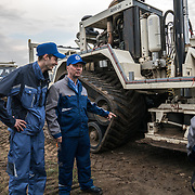 Volgodeminoil and Wintershall personnel with seismic vibrator trucks in Volgograd.