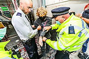 Police intervened and arrested three members of Extinction Rebellion activists group who sprayed Department for Transport Building and some of them pelted it in red, meanwhile some others glued themselves outside the main entrance, in Horseferry Road in central London on Friday, Sept 4, 2020. There are other Extinction Rebellion protests ongoing in London. Police closed Horseferry Road both ways as a group of protestors from Parliament Square marched towards Department for Transport demanding an end of HS2 construction. Environmental nonviolent activists group Extinction Rebellion enters its 4th day of continuous ten days protests to disrupt political institutions throughout peaceful actions swarming central London into a standoff, demanding that central government obeys and delivers Climate Emergency bill. (VXP Photo/ Vudi Xhymshiti)