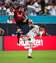 July 31, 2018 - Miami Gardens, Florida, USA - Manchester United F.C. defender Luke Shaw (23) falls on Real Madrid C.F. defender Alvaro Odriozola (19) during an International Champions Cup match between Real Madrid C.F. and Manchester United F.C. at the Hard Rock Stadium in Miami Gardens, Florida. Manchester United F.C. won the game 2-1. (Credit Image: © Mario Houben via ZUMA Wire)