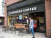 Starbucks coffee young people leaving, Colchester, Essex