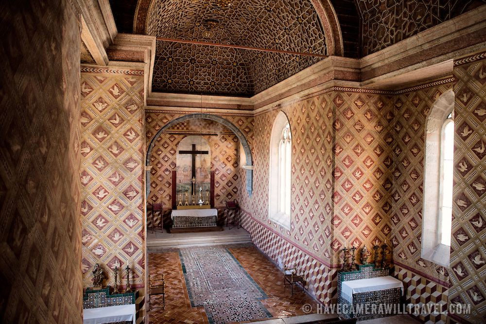 """SINTRA, Portugal - The chapel was built during the reign of King Dinis at the beginning of the 14th century. During the 15th century it was subjected to several alterations, including a decorated ceiling showing Islamic influence, ceramic tile """"carpet"""", and wall frescoes. It was restored in the 1930s. The Palace of Sintra (Palácio Nacional de Sintra) is a mediaeval royal palace in Sintra and part of the UNESCO World Heritage Site that encompasses several sites in and around Sintra, just outside Lisbon. The palace dates to at least the early 15th century and was at its peak during the 15th and 16th centuries. It remains one of the best-preserved royal residences in Portugal."""