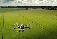 An Aeronavics Skyjib Y6 drone fitted with a Z15 gimbal and GH3 camera surveying a field in Suffolk, England