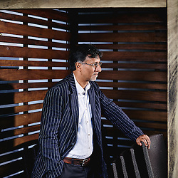 Paris, France. July 29, 2015. Dr Sudhir Hazareesingh is a writer and a University Professor in Politics at Balliol College, Oxford. He poses on a rooftop located upon L'Express' (a news magazine) offices. Photo: Antoine Doyen