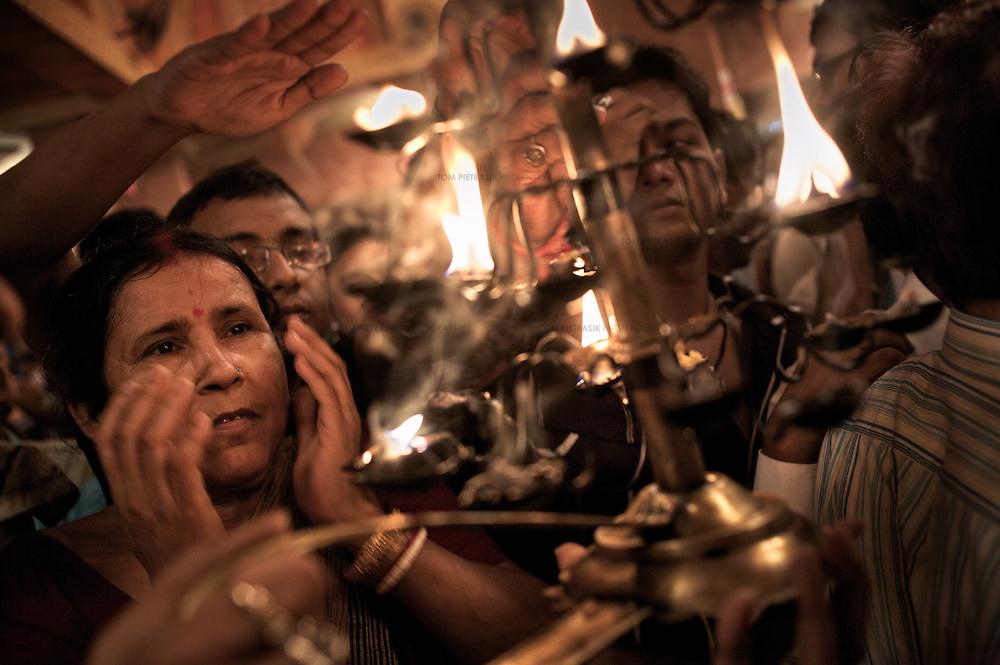 Hindu devotees at Kolkata's annual Durga Puja...Photo: Tom Pietrasik.Kolkata, India.October 2008