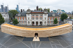 The Smile, an art installation designed by architect Alison Brooks is the world's first 'mega tube made from wood', a landmark project for the London Design Festival, is unveiled at Chelsea Art College in London.  PICTURED: Architect Alison Brooks is dwarfed by her structure as she stands in the entrance. ©Paul Davey<br /> FOR LICENCING CONTACT: Paul Davey +44 (0) 7966 016 296 paul@pauldaveycreative.co.uk