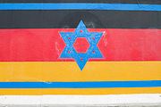 """A section of the Berlin Wall with a the painting """"Vaterland"""" featuring the Star of David and the Israeli flag with the German flag, by the artist Guenther Schaefer. East Side Gallery, Berlin."""