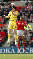 Photo: Leigh Quinnell.<br /> Nottingham Forest v Colchester United. Coca Cola League 1. 08/04/2006. Colchesters Greg Halford beats Forests Julian Bennett in the air.