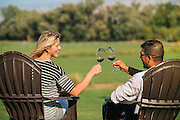A couple toasting at Three Rivers Winery