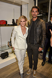 Ashley Roberts and Hugo Taylor at a party to launch Ashley Robert's new footwear range Allyn held ay Larizia, 74 St.John's Wood High Street, London England. 8 February 2017.