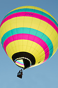 Backlit by the sun, 'Sinbad' glows against a clear blue sky, Crown of Maine Balloon Fair, Presque Isle, Maine.