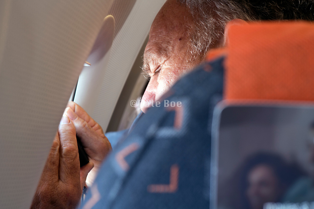 photographing the view from the window of a commercial passenger airplane