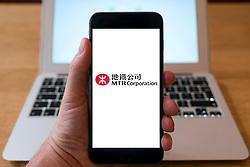 MTR Corporation railway company logo on website on smart phone screen.