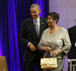 Singer, Aretha Franklin performs in Washington D.C. 16 Aug 2018 Pictured: U.S. President Barack Obama welcomes Aretha Franklin as she arrives to sing at the portrait unveiling ceremony for outgoing U.S. Attorney General Eric Holder at The Department of Justice in Washington, DC, February 27, 2015. Credit: Chris Kleponis / Pool via CNP. Photo credit: CNP / MEGA TheMegaAgency.com +1 888 505 6342