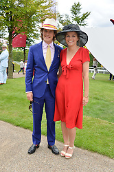 LORD SETTRINGTON and POM OGILVY at the Qatar Goodwood Festival - Ladies Day held at Goodwood Racecourse, West Sussex on 30th July 2015.