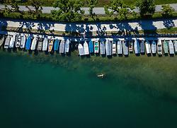 THEMENBILD - eine Frau schwimmt im Zeller See nahe eines Bootssteges, aufgenommen am 30. Juni 2019 in Zell am See, Österreich // a woman swims in the Zeller lake near a jetty, Zell am See, Austria on 2019/06/30. EXPA Pictures © 2019, PhotoCredit: EXPA/ JFK