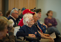 Veterans and family members listen as Governor Sununu speaks during the Veterans Day ceremony at the NH Veterans Home on Friday morning.  (Karen Bobotas/for the Laconia Daily Sun)