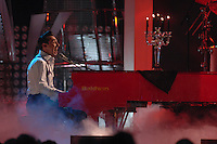 Jakob Hoggard of the Canadian band Hedley plays the piano during the television broadcast of the Juno Awards at the Saddledome in Calgary, Alberta. (Marissa Baecker/Shoot the Breeze)