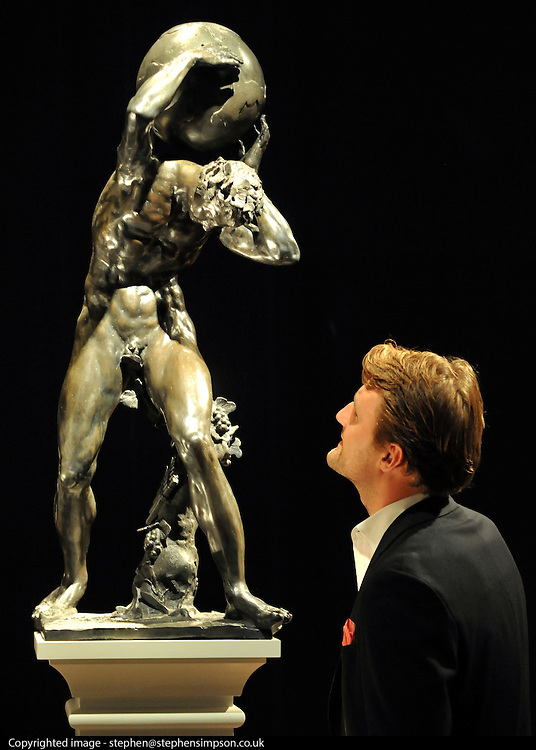 © licensed to London News Pictures. LONDON, UK.  13/06/11. A man looks at the sculpture 'Mythological Figure Supporting the Globe' a previously unrecorded 17th Century masterpiece by Dutch master of Mannerist Sculpture Adriaen de Vries (1550-1626). It was discovered on a routine Christie's evaluation. It is expected to fetch £5-8Million at auction on 7 July 2011. Photo call at Christie's, London, for the unveiling of rarely seen masterpieces by Picasso, Michelangelo and Gainsborough before they are offered for sale. Photo credit should read Stephen Simpson/LNP