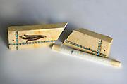 broken mezuzah and parchment