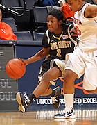 Feb. 3, 2011; Charlottesville, VA, USA; Wake Forest Demon Deacons guard Brooke Thomas (1) drives past Virginia Cavaliers forward/center Erinn Thompson (5) during the game at the John Paul Jones Arena.  Mandatory Credit: Andrew Shurtleff