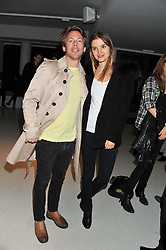 JAMES FABRICANT and ROOS VAN MONTFORT at Diego Bivero-Volpe's 30th birthday party in aid of the charity Kids Company held at the Rook & Raven Gallery, 7 Rathbone Place, London W1 on 12th April 2013.