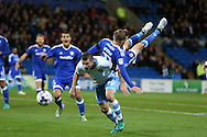 Craig Noone of Cardiff city (no11 on r) tumbles over Daniel Pudil of Sheffield Wednesday (36) as they challenge for the ball.  EFL Skybet championship match, Cardiff city v Sheffield Wednesday at the Cardiff city stadium in Cardiff, South Wales on Wednesday 19th October 2016.<br /> pic by Andrew Orchard, Andrew Orchard sports photography.