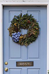 December 21, 2017 - Charleston, South Carolina, United States of America - A blue wooden door of a historic home decorated with a Christmas wreath on Tradd Street in Charleston, SC. (Credit Image: © Richard Ellis via ZUMA Wire)
