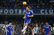 Branislav Ivanovic of Chelsea heading the ball . Barclays Premier league match, Chelsea v Newcastle Utd at Stamford Bridge in London on Saturday 13th February 2016.<br /> pic by John Patrick Fletcher, Andrew Orchard sports photography.