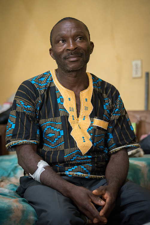 2 November 2019, Ganta, Liberia: David Pomosee is a patient at Ganta Hospital. After not feeling well, he came to the hospital for treatment, and is recovering after receiving medication intravenously. Located in Nimba county, the Ganta United Methodist Hospital serves tens of thousands of patients each year. It is a founding member of the Christian Health Association of Liberia.