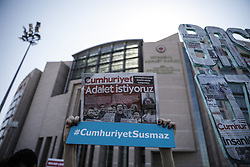 A woman holds a copy of Cumhuriyet newspaper during a rally in front of the Istanbul Courthouse in Istanbul, Turkey, 24 July 2017. Employees from the Cumhuriyet newspaper are facing trial, 24 July 2017, on charges of aiding a terrorist organisation that carry sentences up to 43 years. Turkish police detained the editor-in-chief of the opposition newspaper Cumhuriyet, Murat Sabuncu, columnist Hikmet Cetinkaya and issued 13 arrest warrants for journalists and executives during a police operation on 31 October 2016.Photo by Can Erok/DHA/Depo Photos/ABACAPRESS.COM