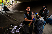 Charles Timberger, 51, who is experiencing homelessness, gets the Johnson & Johnson COVID-19 vaccine under the W/X freeway in Sacramento on Thursday, March 18, 2021.