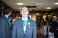 groom waiting down aisle for bride to arrive