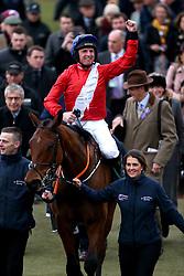 Jockey Jamie Codd (centre) celebrates winning the Weatherbys Champion Bumper on Envoi Allen during Ladies Day of the 2019 Cheltenham Festival at Cheltenham Racecourse.