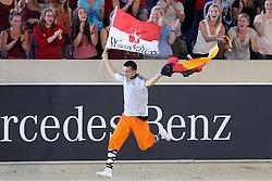 22.08.2015, Aachener Soers, Aachen, GER, FEI Europameisterschaften Aachen 2015, Finale Herren-Kuer, Voltigieren, im Bild Europameister Jannis Drewell (GER) jubelt mit der Deutschland und der Westfalenfahne zum Titel mit Pferd Diabolus 3 und Longenfuehrerin Simone Drewell (GER) // during Final Men, Vaulting of FEI European Championships Aachen 2015 at the Aachener Soers in Aachen, Germany on 2015/08/22. EXPA Pictures © 2015, PhotoCredit: EXPA/ Eibner-Pressefoto/ RRZ<br /> <br /> *****ATTENTION - OUT of GER*****