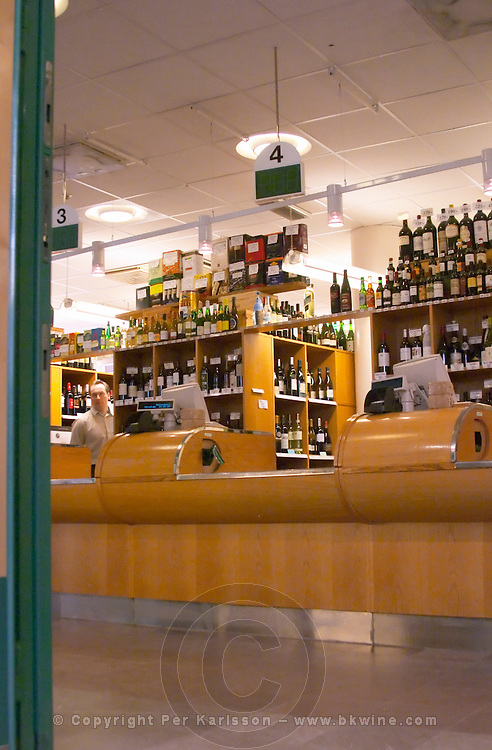 The customer counter in a traditional style Systembolaget shop the alcohol wine beer spirit monopoly retailer in Sweden. All bottles are asked for and delivered over the counter. Stockholm, Sweden, Sverige, Europe