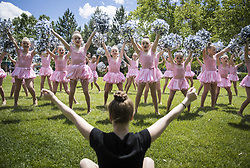 June 20, 2017 - Burnsville, MN, USA - Teacher assistant Olivia Lind led a practice and warm up with a group of ''mini pom'' dancers from the Woodbury Dance Center at the Heart of the City park in Burnsville, Minn., before they performed at the Masquerade National Finals competition at the nearby Ames Center on Tuesday, June 20, 2017. ] RENEE JONES SCHNEIDER Â¥ renee.jones@startribune.com (Credit Image: © Renee Jones Schneider/Minneapolis Star Tribune via ZUMA Wire)
