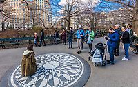 NEW YORK CITY- MARCH 23, 2018 : Tourist at the Strawberry Fields John Lennon memorial one of the main Manhattan Landmarks