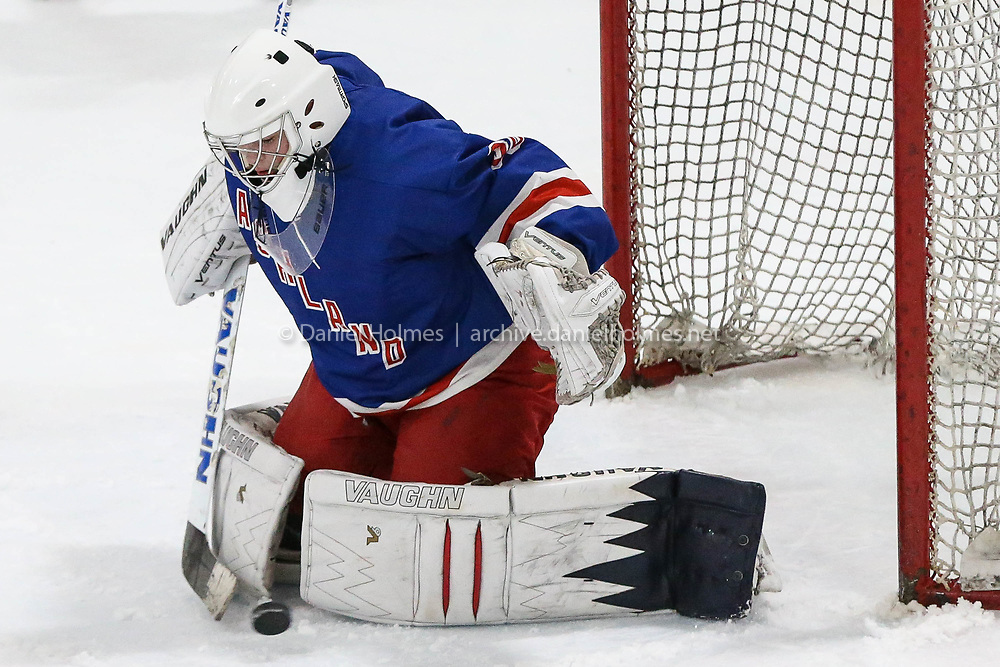 (1/20/18, MARLBOROUGH, MA) Ashland goalie Michael Lowd makes a save during the boys hockey game against Hopkinton at the New England Sports Center in Marlborough on Saturday. [Daily News and Wicked Local Photo/Dan Holmes]