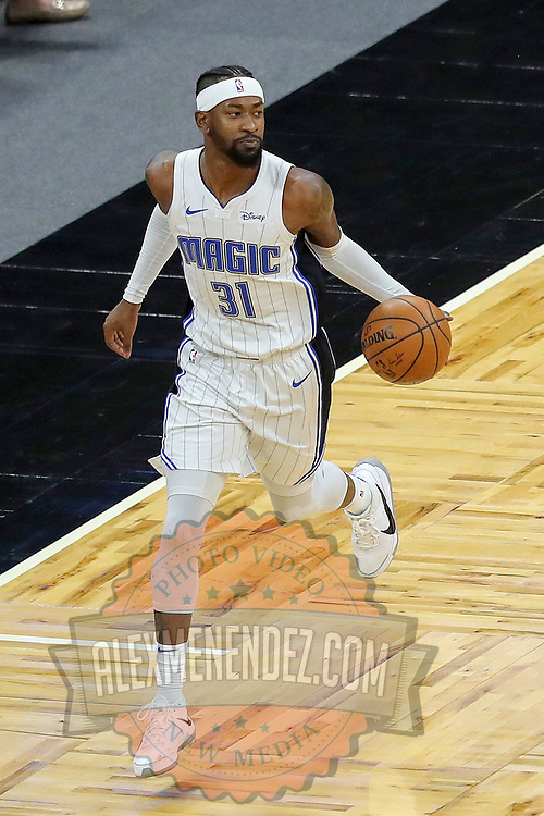 ORLANDO, FL - FEBRUARY 23:  Terrence Ross #31 of the Orlando Magic controls the ball against the Detroit Pistons at Amway Center on February 23, 2021 in Orlando, Florida. NOTE TO USER: User expressly acknowledges and agrees that, by downloading and or using this photograph, User is consenting to the terms and conditions of the Getty Images License Agreement. (Photo by Alex Menendez/Getty Images)*** Local Caption *** Terrence Ross