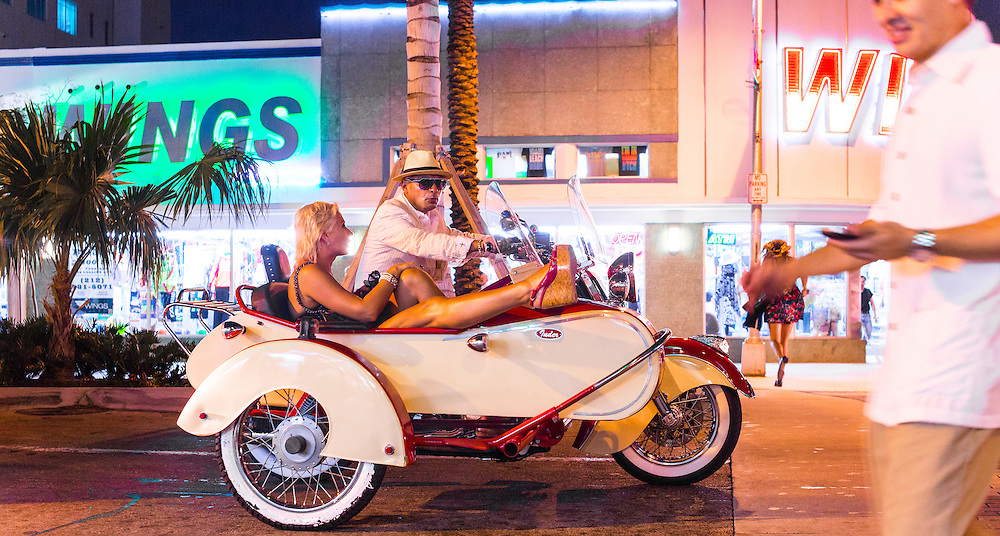 A couple on a motorcycle with sidecar on Miami Beach's Lincoln Road, near the main exhibition hall and several satellite art fairs during Miami Art Week 2012