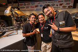 Yuichi Yoshizawa and Yoshikazu Ueda of Custom Works Zon in Japan with Michael Lichter  on the Industry party night for Michael Lichter's tattoo themed Skin & Bones Motorcycles as Art exhibition at the Buffalo Chip during the annual Sturgis Black Hills Motorcycle Rally.  SD, USA.  August 7, 2016.  Photography ©2016 Michael Lichter.
