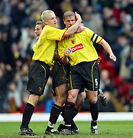 Photo: Scott Heavey.<br />Watford v Sunderland. Nationwide Division One. 07/02/2004.<br />Neil Cox is mobbed after scoring Watfords second from the penalty spot