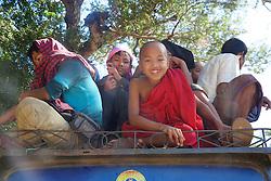 Boy With Play Gun On Local Transportation Near Shwezigon Pagoda