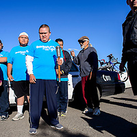 052714       Cable Hoover<br /> <br /> Nathan Begay, center, and other athletes and volunteers gather together to begin the Special Olympics torch run in Gallup Tuesday.